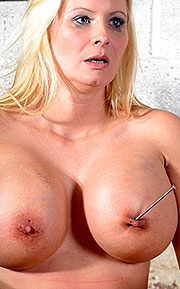 nailed tits torture
